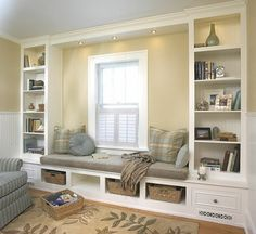 Window seat and built in shelving system. I love the idea of having a reading bench beside a window I've always wanted one of these.