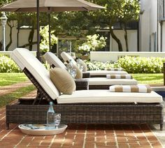 All-weather wicker chaise for easy outdoor living.
