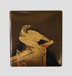 "A gold and silver lacquer on a black ground ""suzuribako"" decorated with the portrait of a hunter's hawk. Japan Edo period (1603-1868), 19th century, 23 x 24,5 x 4,2 cm."