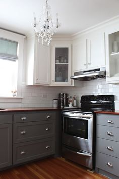 Modern Jane: Stunning two-tone kitchen features lower cabinets painted gray, Benjamin Moore Whale ...