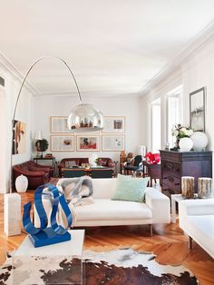 A living room with two sitting areas, decorated by Sara Arroyo. Sculpture Rafael Amoros
