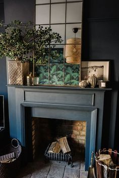 A gorgeous dark and moody, eclectic and glamorous living room design from Fiona Duke interiors with lovely copper framed mirror, botanical, tropical style influences and great fireplace styling. above fireplace mantle Dark Living Rooms, Living Room With Fireplace, Living Room Interior, Living Room Decor, Dark Rooms, Small Living, Cozy Living, Piano Living Rooms, Front Room Decor