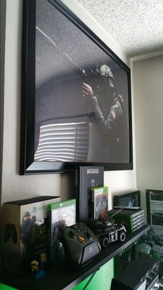 Gaming shelve, Xbox One, Battlefield 3 Collector's edition guide, and much more  2016 gaming setup.