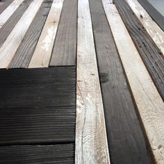Reclaimed wood American Flag in black and white. The black color is achieved by Shou Sugi Ban, a traditional Japanese technique of charring the