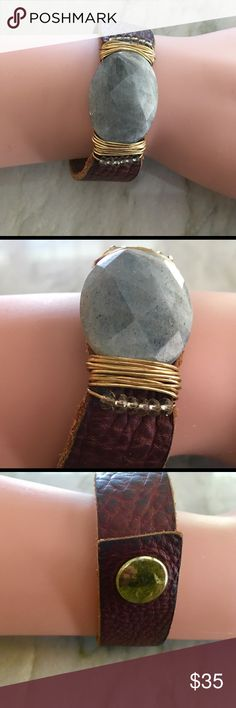 Wild Feather & Stone Small Leather Cuff Worn just a few times & in perfect condition is a Handmade from Aspen Colorado a Wild Feather & Stone Small Leather Cuff. Labradorite wrapped into a rich Saddle tan leather with a snap fastener. Wild Feather & Stone Jewelry Bracelets