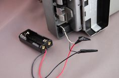 battery conversionmod #2: rig a 2-cell AAA battery holder (Radioshack part #270-398B, or equivalent) as alternative to auto polaroid land camera's standard 3v #532