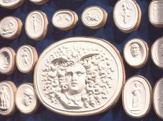 Intaglio Medallions like these...to be placed in groupings around my living room fireplace!