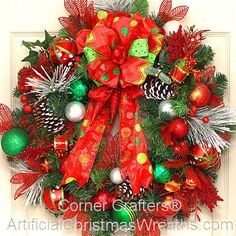 Merry Christmas Wreath - 2015 - Our Deluxe Merry Christmas Wreath is adorned with an abundance of Holiday picks, Christmas balls, glittered snowflakes, pine cones and snowy tipped branches. A lovely multi layered bow completes this wreath. #ChristmasWreath