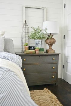 Urbane bronze nighstands – The perfect dark gray paint for furniture. Master bedroom nigh stands styled for spring
