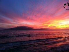 My grandson paddling in the sunset- West Maui