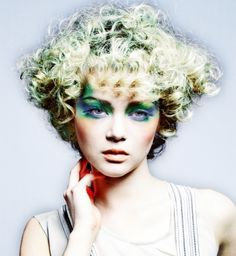 A long blonde curly coloured Multi-Tonal spikey Curly Hair Style Womens hairstyle by Antonio Giovanni