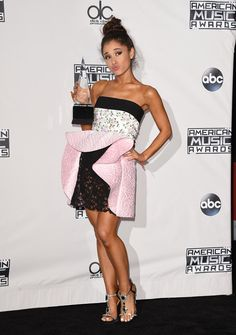 Recording artist Ariana Grande, winner of Favorite Pop/Rock Female Artist, poses in the press room in her Giambattista Valli dress during the 2015 American Music Awards at Microsoft Theater in Los Angeles, California.