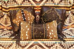 Decorative leather pillows with Axis Deer fur, fringe, and Western tooling by Stargazer Mercantile