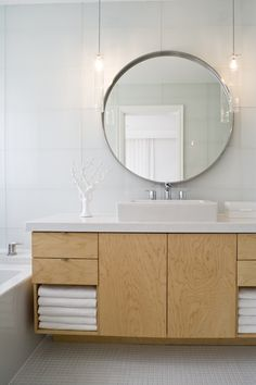 Pendants over a vanity are a nice way to get light down to you without as much shadow. The light is reflected nicely off the wall.