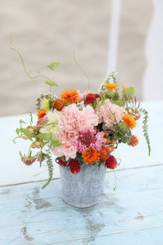 A bucket full of blooms ~ Photography by bschwartzphotography.com