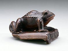 Matsuda Sukenaga (Japan, 1800 - 1871)   Frog on Roof Tile, mid-19th century  Netsuke, Wood with inlays. LACMA