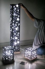 Use a poster board, any kind of squared wood for bottom with edges and christmas lights. Cut any size holes in the posterboard . christmas lights sit on bottom of square. shape the poster board and use a thin line of hot glue to hold them together. Night lights!