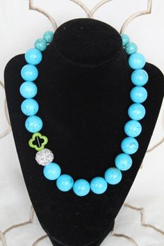 turquoise balls statement necklace with one bling ball as an accent