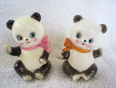 These two pandas are so cute, with their happy faces and blue eyes. Each one has a plastic stopper and a red foil Japan label which leads me to