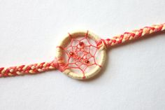 Fun and bright for summertime fadhion. // Sunshine Dreamcatcher Bracelet by ItDoesntMatterInk on Etsy