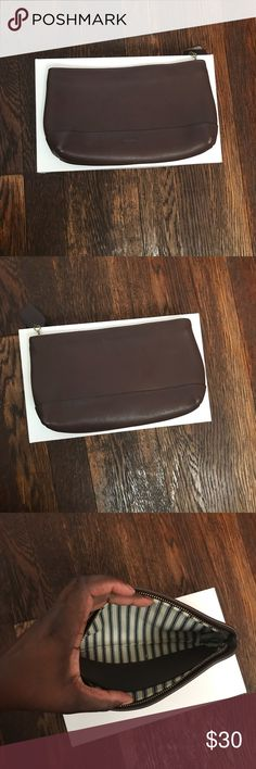 """Vintage Coach Clutch Brown leather coach clutch. One pocket on the inside . 9"""" W 5""""Height 2"""" Depth. A few scuffs in the read (see photo) Coach Bags Clutches & Wristlets"""