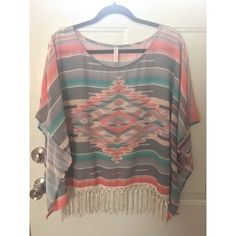 Xhilaration Flowy Aztec Print Top 🎍 Aztec print poncho look top with fringe trim. worn once, like new condition. size l/xl but it just fits me at a size 16 so its forgiving. would look better on someone smaller though. Xhilaration Tops Blouses