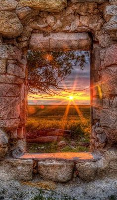 A Kansas sunset through the window of an abandoned and forgotten limestone house in Ellis County … • photo: Thomas Zimmerman on FineArtAmerica