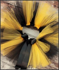 Yellow and BlackTutu-Bumble bee tutus-Bee birthday-Bumble bee birthday party-Bee Costume. $23.99, via Etsy.