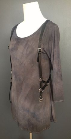 This leather harness vest is the perfect item to spice up that old boring white tee this summer. This hand crafted open harness vest is made of