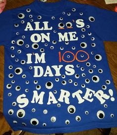 100th day of school shirt I made for my son which is in Kindergarten. You will need a shirt,Googly eyes, fabric glue, color fabric paint, and iron-ons