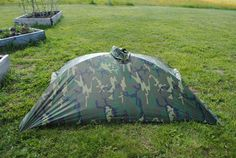 Alpha tent, fashioned from nothing more than a USGI Military Issue Poncho, tent poles and 4 wire nuts.  Thats it!