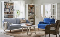 """A bright living room in traditional style u. with STOCKSUND 3 seater sofa with """"Remvallen"""" cover blue / white and light brown wooden legs- Accent Chairs For Living Room, Formal Living Rooms, Living Room Lighting, Living Room Sofa, Living Room Decor, Dining Room, Ikea Armchair, Blue Armchair, Ikea Stocksund"""