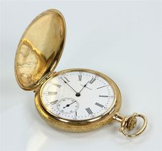 "Waltham 14K yellow gold hunter case pocket watch, case marked ""Dueber,"" engraved with house and mountain scene, 1 3/4"" dia (case), approximately 67 grams TW."