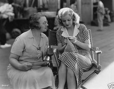 Jean Harlow, famous American movie star, knitting on the set