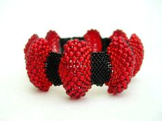 Bumpy Peyote Bracelet in Red and Black Beadwoven Handmade Hot Statement Comfortable Seed Beading. $38.00, via Etsy.