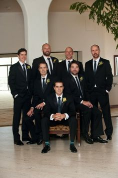 Great shot of the all the guys.  Love how the groom is seated with the groomsmen behind him.