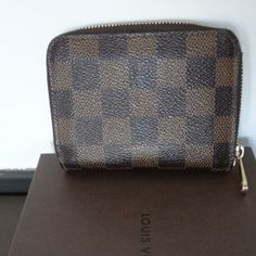 Tip: Louis Vuitton Small leather good (Dark Brown)