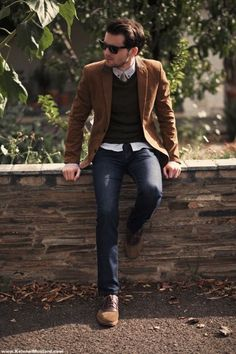 Shop this look on Lookastic: https://lookastic.com/men/looks/blazer-v-neck-sweater-dress-shirt-chinos-oxford-shoes-tie/2641 — Brown Blazer — Dark Brown V-neck Sweater — Light Blue Dress Shirt — Grey Tie — Navy Chinos — Brown Leather Oxford Shoes