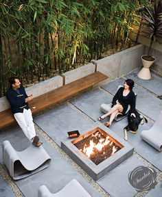 Magnificent contemporary modern patio design with stylish Loop Chairs.  http://www.stardust.com/loopchair.html