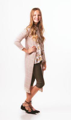 Tween long cardigan with tassel trim.