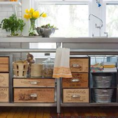 Old crates and tin pails for kitchen storage.