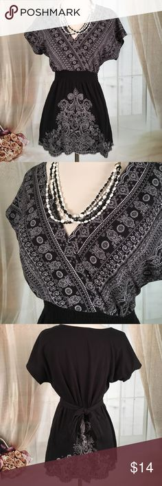 ✨Host Pick✨ Roz & Ali Black Short Sleeved Blouse Today, featuring in Kaki Jo's closet is this super cute black top.  Long enough to wear with a pair of leggings.  Elastic at the waist and ties in the back.  New condition.  Size M. Note: necklace not included. Roz & Ali Tops Blouses