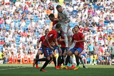 Real Madrid's Sergio Ramos heads to score during the match