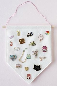 Make your own felt banner store store and display your enamel pin collection with this tutorial from Felicette!