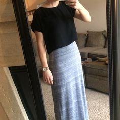 Black Crop Tee This black crop tee is adorable to put over a long skirt or to wear with some high waisted shorts. The tee has a little pocket and is so comfy to wear. Extremely flowy and flattering. Size M but really fits more like a S. Great condition. Tops
