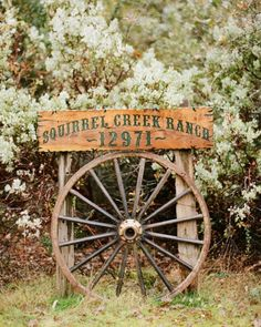A Romantic, Rustic DIY Wedding on a Ranch in California Wagon wheel house sign Outdoor Signs, Rustic Outdoor, Outdoor Decor, Driveway Sign, Driveway Entrance, Driveway Ideas, Driveway Landscaping, Address Signs For Yard, Wagon Wheel Decor