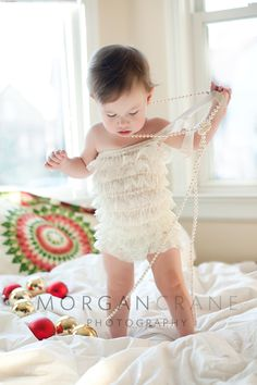 Baby in petti-romper with pearls. Morgan Crane Photography