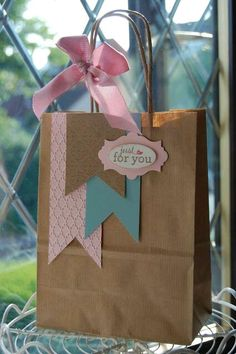 DIY Decorated Gift bags ~ Cute way to reuse shopping bags.just cover the logo with more paper then add cute accents Paper Gift Bags, Paper Gifts, Diy Paper, Creative Gift Wrapping, Creative Gifts, Craft Gifts, Diy Gifts, Decorated Gift Bags, Gift Wraping