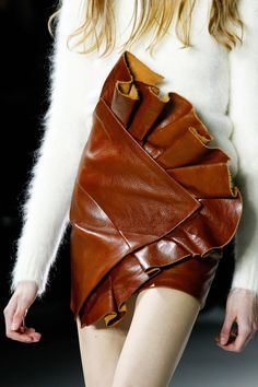 See detail photos for Saint Laurent Fall 2017 Ready-to-Wear collection. leather skirt