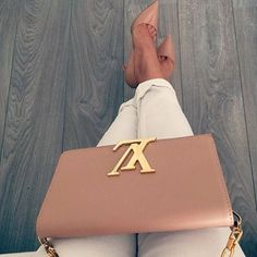 Chic Louis Vuitton cross-body paired with classic Christian Louboutin's women handbags and purses